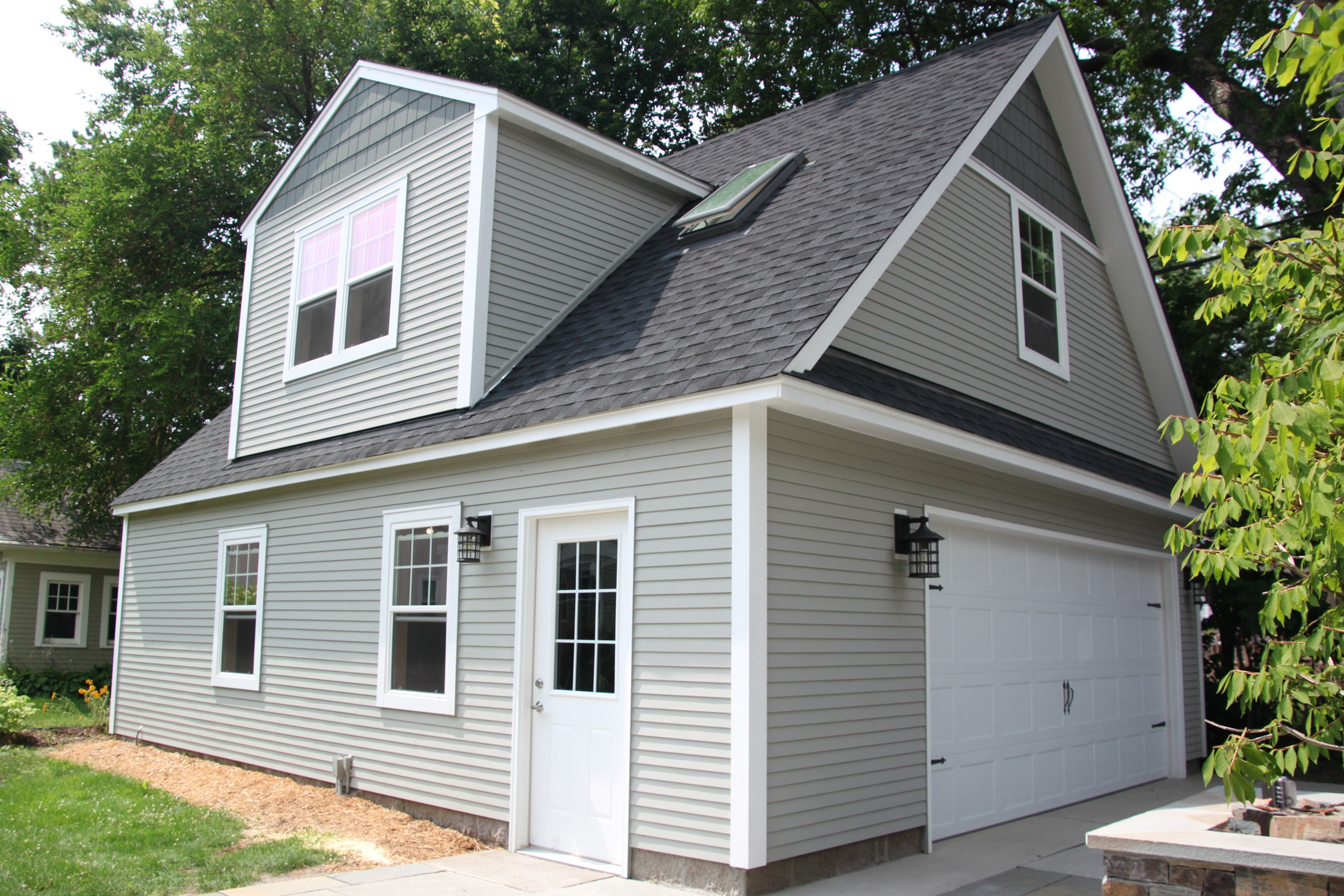 2 car 2 story garage using attic trusses and dormer for Cost of james hardie siding