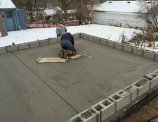 Garage slab construction how to protect concrete in cold for What temperature to pour concrete outside