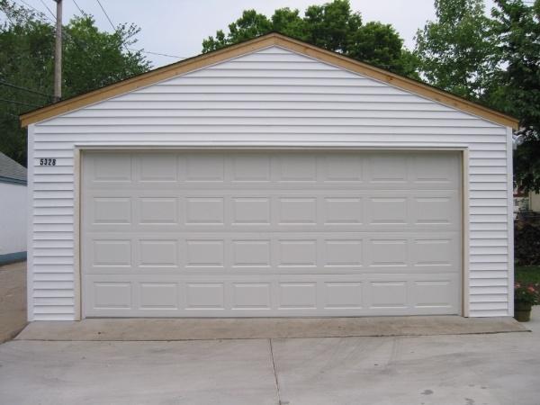 2 car garage vinyl siding wood soffit and fascia-edited.jpg